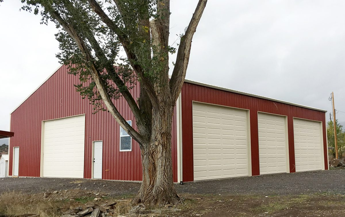 Large Metal Building with 3 Roll Up Garage Doors